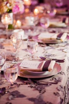 Wedding place setting with custom individual menus on silver chargerplates. Textured grey petal table linens and ivory napkins banded in gry ribbon.