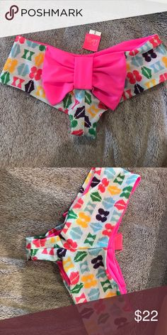 LOLLI SWIM LIMITED EDITION BOW BOTTOMS So cute comfortable too. Very flattering on all body types. Limited edition!! Size medium but could fit a small perfectly. Only tried on but I have never worn Lolli Swim Bikinis