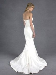 This strapless bridal gown is elegant and classically simple. The sweetheart neckline and fitted bodice are figure-flattering and create a streamlined look. A fishtail train is the finishing touch to this sophisticated and modern gown.