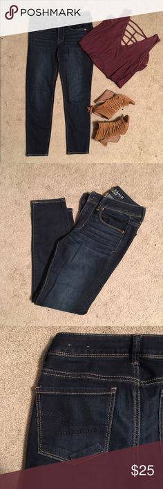 Dark Wash Skinny American Eagle Jeans These are a must have in every women's closet! A nice dark wash pair of skinny jeans! The pockets have a nice dark stitching, they are mid rise, stretchy (but nice thicker material.) These are a size 2 short, but could fit a 0 as well (that's what i am.) worn less than a handful of times! So much life left in these jeans! American Eagle Outfitters Jeans Skinny