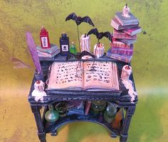 Collector Miniature 1:12 Potion TABLE Desk, Flying BATS, BOOKS, Candles, more. Loaded. ooak by PatriciaPaulStudio on Etsy https://www.etsy.com/listing/524476910/collector-miniature-112-potion-table