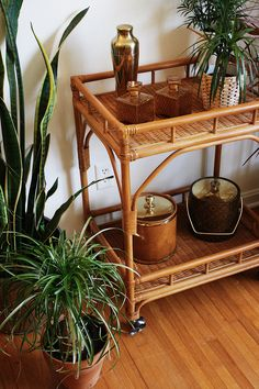 Pretty bamboo rattan bar cart. Perfect eclectic addition to any home wanting some character! Excellent condition. Very functional, rolls very smoothly. Could also be used as a plant stand! Please contact us with your zip code for a shipping quote. Shipping IS NOT included in the price. Dimensions: 39 in. tall to handle 24 in. long 18 in. wide
