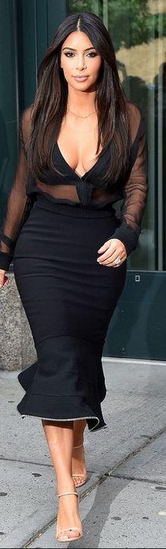 Kim Kardashian, black mesh top, mermaid flare skirt, and nude sandals