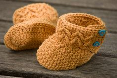These crochet booties are designed to keep the wee one's feet warm in style. The tall shaft of the boot ensures these fashion-forward booties will stay on while the buttons make them easy to put on and take off. Crochet baby booties handmade with love are the perfect accessories for baby's wardrobe.