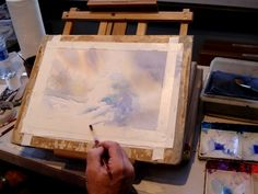 Artist Roland Lee demonstrates how to paint a snow scene in watercolor using negative painting technique showing underglazes with wetinto wet technique