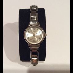 Nomination watch/ bracelet This stainless steel watch contains a variety of removable charms. In like new condition except Watch needs battery. Stretch band on watch. Jewelry Bracelets