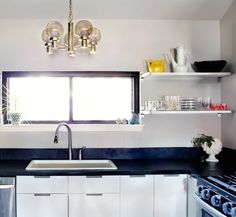 our Kitchen look like this: a window and a sink, the oven after the corner