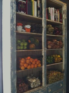 vintage cabinet for fruit and vegetables in baskets with cookbooks on top - this would be wonderful in my kitchen!