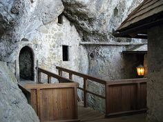 Inside the Predjama Castle, you can see how it is built in and among the natural rock walls.