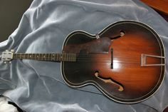 Harmony Tenor guitar on Ebay. I love old Tenors, Mostly the crappy ones,like Stella and harmony. Plywood tops....yup. A good tenor is pretty awesome, too.