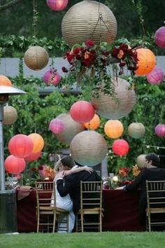 Gorgeous multi-sized and colored paper lanterns decor for a modern outdoor wedding reception