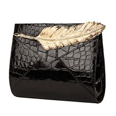 Ines Figaredo black crocodile leather clutch with gilded bronze feather (€4,200). Debuted Nov 2015. Click for more details