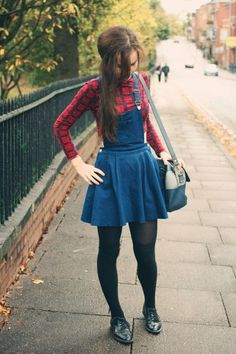 Overall skirt and checkered shirt