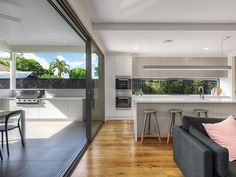 A kalka kitchen and outdoor entertainment area in a small lot home in Wooloowin, Brisbane.