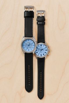 His everyday watch is updated with a hint of tint! This season's pop of blue with a silver-tone case and classic black leather straps are a must-have.