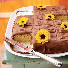 Yellow sheet cake with chocolate frosting. You can garnish with edible flowers, sprinkles, nuts or chopped candy.