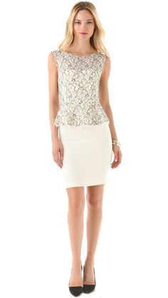 Would have no reason to wear this but its just gorgeous....  alice + olivia Shovan Peplum Dress with Open Back