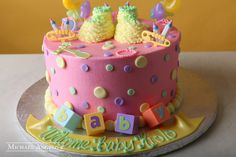 Booties & Pins This round cake is iced in a buttercream and decorated with polka dots , buttercream booties and baby toys. Lemon Mousse, Raspberry Mousse, Afternoon Tea Cakes, Buttercream Filling, Wilton Cakes, Cake Flavors, Round Cakes, Tiered Cakes, Baby Shower Cakes