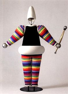 OSKAR SCHLEMMER- Triadisches Ballet... Did you ever have those stacking hoops on a prong?