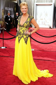 Nancy O'Dell.  I didn't watch the awards, just looked at the pics of the red carpet dresses. This was BY FAR my favorite!