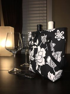 A personal favorite from my Etsy shop https://www.etsy.com/listing/517885417/wine-bag-purse-tote-the-xindi-black-and