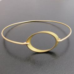 Forever Bangle Bracelet (but in silver) together with the leaf and a stone in a neutral color