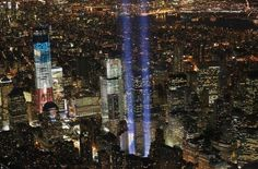 The Tribute in Light shines as One World Trade Center (l.) rises under construction on the eleventh anniversary of the terrorist attacks on lower Manhattan at the World Trade Center on September 11, 2012, in New York City.