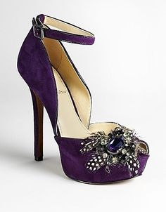 remarkable little shoe!  Try an aubergine cocktail dress instead of the traditional black for a night on the town!  Wear with a red dress to really steal the show :)