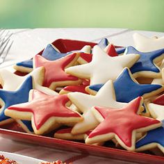 """Lemon Nut Star Cookies Recipe -Family and friends will say """"Hooray!"""" when they see these star-spangled cookies from our Test Kitchen. Make these treats throughout the year by using different cookie cutter and food coloring. Star Cookies, Cake Cookies, Cupcakes, Lemon Cookies, 4th Of July Party, Fourth Of July, Patriotic Desserts, Patriotic Party, Independance Day"""