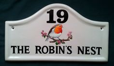 Small Arch House Sign with Robin painting.  See more of our ceramic house signs with robins on our website www.handpaintedhousesigns.co.uk
