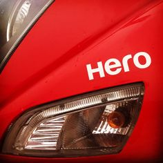 Loved this shot so crazily!! Captured it yesterday's evening! The name HERO. My Premika  now and then calls me HERO which always keep me a bit inspired and energetic! Love you sweetheart! U always energise me! I always want to be your best HERO forever! #hero #bike #heromotocorp #harekrsna7495 #red #light