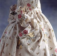Close view of a Mantua Court Dress at Springhill, County Londonderry, Northern Ireland showing embroidered flowers and leaves