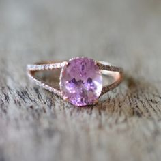 A natural super fine blush pink untreated peach sapphire. with super luster. Gold ring with more than 70 tiny G/H SI about 0.5 carat full cut diamonds.
