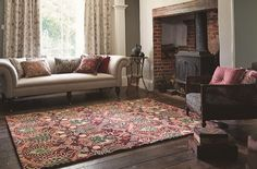 Granada Rug William Morris first produced the Granada design in 1884. Specifically adapted for rugs, the beautiful  pomegranate design is coloured in sumptuous indigo blues and rich reds.