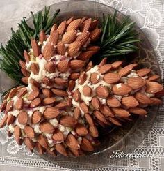 Новогодний салат Шишка New Year's RecipesRing in the New Year with some of our favorite New Year's Eve recipes, menu ideas, party foods and more. These celebratory dishes are a great way to start the year out right. Happy New Year ! Raw Food Recipes, Veggie Recipes, Veggie Food, School Holiday Baking, Top Salad Recipe, Best Party Food, New Year's Food, Food Garnishes, Food Decoration