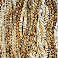 Bone beads are great for light summer jewelry.  Most bone beads are made from a kind water buffalo because their bones are denser than cow bone.  They are not endangered and are not just killed for the purpose of making beads!
