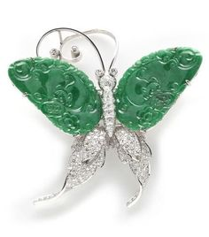 A CARVED JADEITE JADE AND DIAMOND BUTTERFLY BROOCH