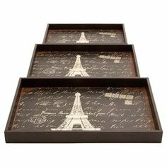 """Bring Parisian flair to the entryway console table or your next soiree with this wood tray set, showcasing an antiqued carte postale-inspired Eiffel Tower motif.  Product: Small, medium and large trayConstruction Material: WoodColor: Brown and ivoryFeatures: Cutout handlesDimensions: Small: 0.5"""" H x 17"""" W x 11"""" D Medium: 2"""" H x 19"""" W x 13"""" D Large: 2"""" H x 21"""" W x 15"""" D"""