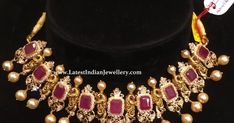 Beautiful nakshi peacocks separated by square cut rubies surrounded with tiny CZs. This beautiful 22 karat gold choker necklace with south sea pearl drops weighs 47 gms net gold. Gold Bangles Design, Gold Jewellery Design, Gold Jewelry, Chokers, Choker Necklaces, Earrings, Gold Choker, Small Necklace, Short Necklace