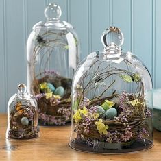 Use clear glass hurricanes to create your own Easter themed terrariums- they're showstoppers! Find wonderful Easter recipes, crafts, DIY projects and more at http://simplycreate.com/.
