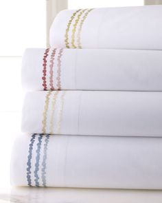 SFERRA's Crandall sheet sets for Horchow are made of the cool, crisp percale cotton that's perfect for tropical nights. Finished with jazzy embroidery in 4 sea-inspired hues.