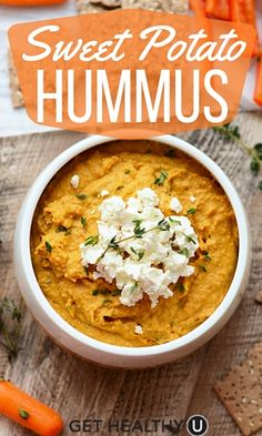 This Sweet Potato Hummus recipe is the perfect healthy snacking dip packed with fiber and protein, not to mention SUPER delicious with the fresh thyme and goat cheese on top.