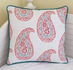 Large paisley design in coral and turquoise on a creamy white background. The fabric is a heavy linen. The same fabric is used on BOTH sides with