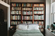 Decor inspiration for bookworms, including this beautiful bedroom which keeps books right in reach.
