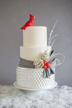 white and silver winter wedding cake with berries, pinecones and cardinal cake topper ~ we ❤ this! moncheribridals.com