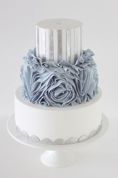 White, silver, and blue ruffle wedding cake