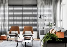 〚 Black and white apartment with warm accents in Tel Aviv (110 sqm) 〛 ◾ Photos ◾ Ideas ◾ Design #livingroom #grey #sofa #louvers #interior #design #homedecor #home #decor #interiordesign #idea #inspiration #cozy #living #space #style