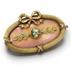 A FABERGÉ GOLD AND ENAMEL BROOCH, WORKMASTER ALFRED THIELEMANN, ST. PETERSBURG, CIRCA 1910 of oval shape, with ribbon-tied reeded border, the field enamel translucent rose over a guilloché ground, mounted with a faceted citrine