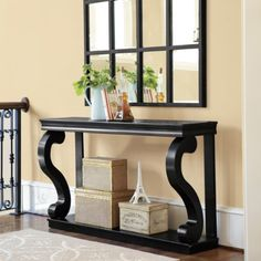 "The substantial scale and exaggerated cabriole legs make a dramatic visual statement. The Console's sweeping, molded crown and substantial ""S"" shaped legs make a dramatic statement, while the open shelf beneath maintains a feeling of space in the entry, dining room or hall."