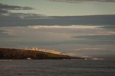 Long lens towards Dunstanburgh castle